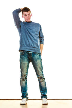 Young fashionable man teen boy in full length casual style blue jeans posing isolated on white Stock Photo