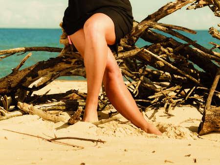 foots: Woman legs on beach. Slim body foots summer outdoor. Stock Photo