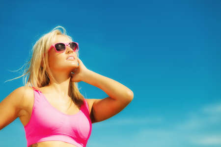 sexual activities: Holidays, summer active lifestyle concept. Attractive blonde fit fitness girl on beach. Young sporty woman relaxing on the sea coast.
