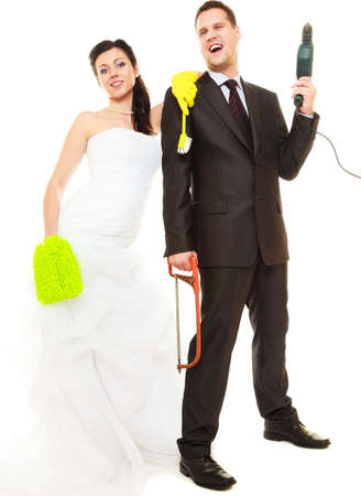 chores: Housework concept. Humorous funny couple bride groom in domestic role, sharing household chores. Isolated on white background.