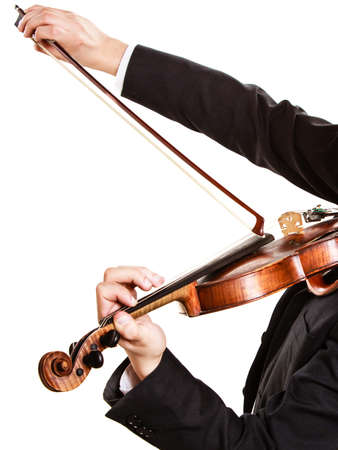 fiddler: Art and artist. Closeup of male hands. Man violinist fiddler playing violin isolated on white. Classical music. Studio shot.