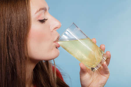 fizzy tablet: Woman drinking effervescent painkiller pill dissolved in glass of water. Health care. Headache and pain. Stock Photo