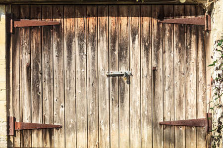 barn doors: Grungy old brown barn doors with natural wood plank Stock Photo