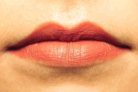 makeover: Cosmetic procedures and beauty makeover concept. Closeup part of woman face red lips makeup detail. Lipstick or lipgloss