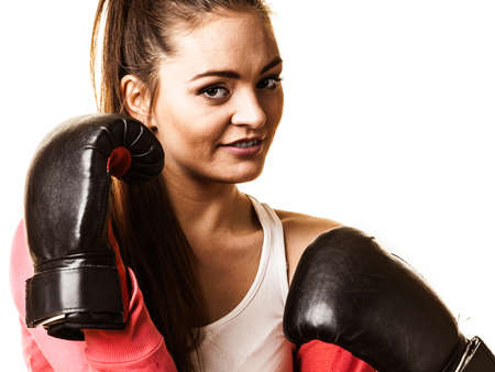 emancipation: Emancipation and feminist. Defense concept. Young fit woman boxing isolated on white.