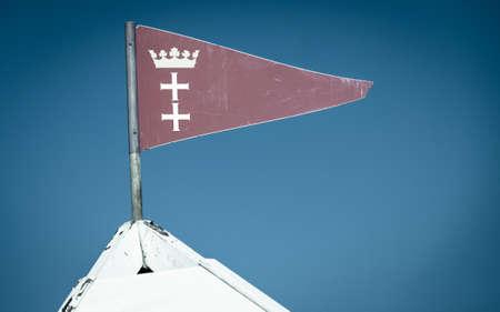 city coat of arms: Emblem coat of arms city Gdansk Danzig Poland Europe, blue sky background