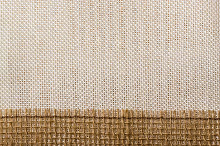 sack cloth: Jute bagging ribbon on bright textile material, sack cloth background Stock Photo