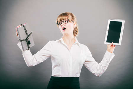 file folder: Businesswoman holding document and tablet. Choice between digital and physical data storage. Woman with padlock chained file and pc computer.