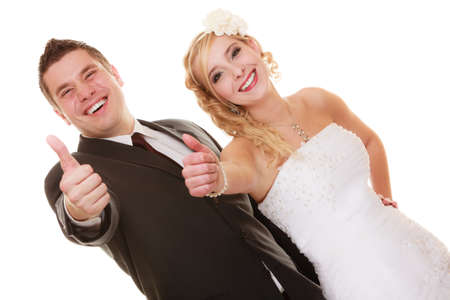 nuptial: Wedding day. Portrait of happy couple bride and groom showing thumb up hand sign gesture isolated on white