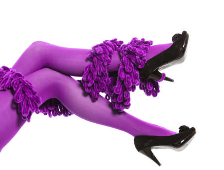 legs around: Female fashion. Woman long legs color purple stockings high heels and warm scarf around leg isolated
