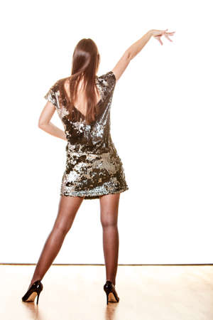 woman dancing: Party celebration and carnival concept. Elegant woman in evening sequin dress dancing isolated on white background.