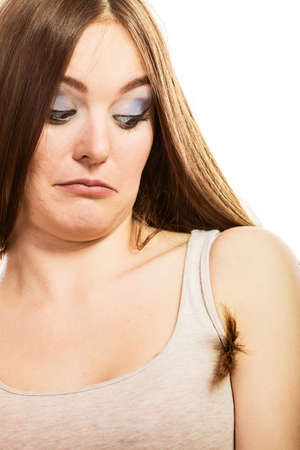 armpit: Daily skin care and hygiene. Funny woman with armpit long hair on white