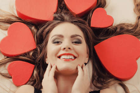 love shape: Portrait of happy woman. Attractive young girl with heart shape boxes around head. Valentines day love.  Stock Photo