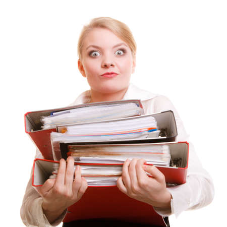 stack of papers: Business and paperwork. Young overworked businesswoman holding stack of folders documents. Busy woman working in office.