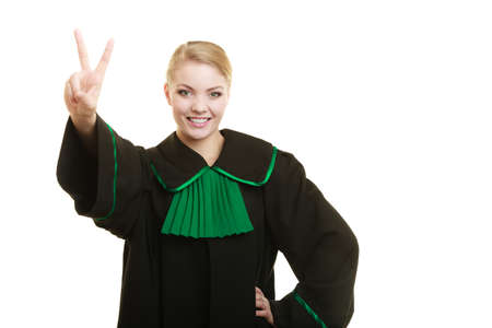 Law court or justice concept. Young woman lawyer attorney wearing classic polish black green gown making ok sign victory hand gesture isolated on white background Stock Photo