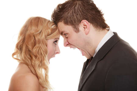 relationship difficulties: Wedding couple relationship difficulties. Angry woman man yelling at each other. Portrait fury bride groom. Face to face. Negative bad communication human emotions facial expression.