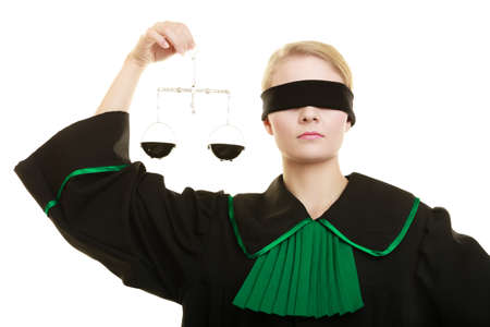 advocate: Law court concept. Woman lawyer wearing classic polish black green gown with covered eyes holds scales. Femida - symbol sign of justice. isolated on white Stock Photo