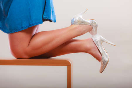 table skirt: Closeup of sexy slim dancing woman legs wearing high heels and skirt. Pin up fashion. Stock Photo