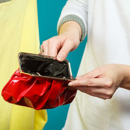 lack: Broke human hands holding empty wallet purse. Lack of money for fashion clothes. Crisis and weak economy concept.