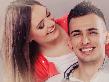 feel feeling: Woman kissing man in cheek. Wife and husband flirting. Happy joyful couple. Good relationship.