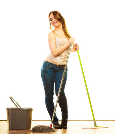 mops: Cleanup housework concept. Funny cleaning girl young woman mopping floor, holding two mops new and old white background