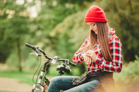 active lifestyle: Fall active lifestyle concept,. Beauty young woman sporty casual girl relaxing in autumnal park with bicycle, outdoor