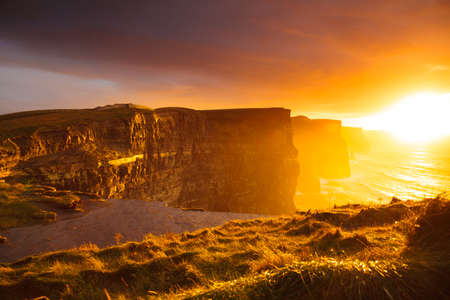 moher: Famous cliffs of Moher at sunset in Co. Clare Ireland Europe. Beautiful landscape natural attraction.