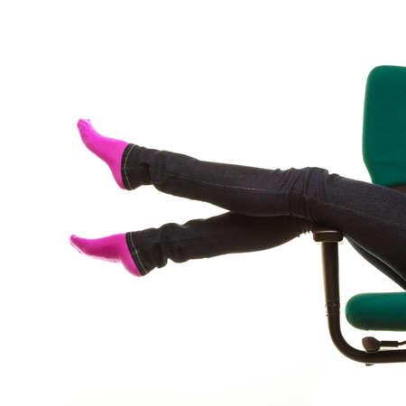 carefree teenage girl female legs in warm socks, college student sitting on wheel chair relaxincarefree teenage girl female legs in warm socks, college student sitting on wheel chair relaxing. Isolated on white backgroundg. Isolated on white background