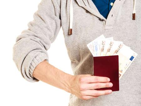 spendthrift: Tourist holding passport full of money. Summer vacation travel. Isolated on white background. Stock Photo