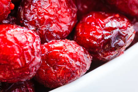 cranberry fruit: Healthy high fiber foods, organic nutrition. Close up dried cranberries cranberry fruit in white bowl.