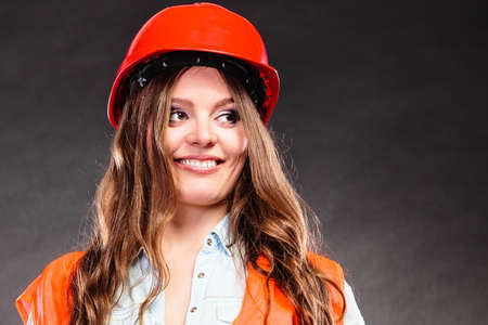 structural engineers: Portrait of pretty woman structural engineer wearing helmet. Girl working in man profession. Independent female.