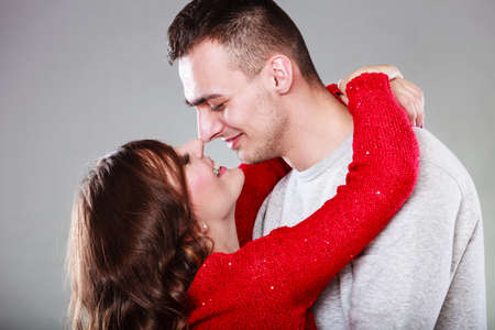 man face: Portrait of young couple woman man face to face gray background