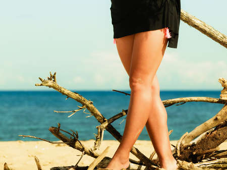 sexual girl: Woman legs on beach. Slim body foots summer outdoor. Stock Photo