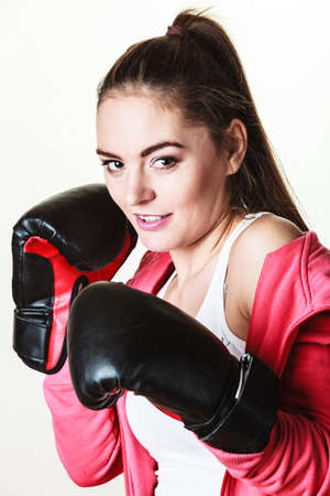 �mancipation: Emancipation and feminist. Defense concept. Young fit woman boxing