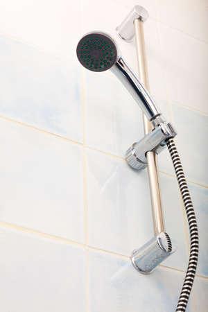 chrome: Closeup of chrome shower head in home bathroom.