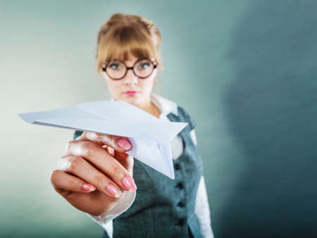 bother: Fly fear metaphor, aerophobia concept. Business woman holding airplane in hand.