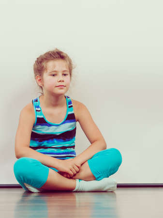 lonely person: Sad unhappy little girl kid in studio. Lonely depressed child. Bad mood.