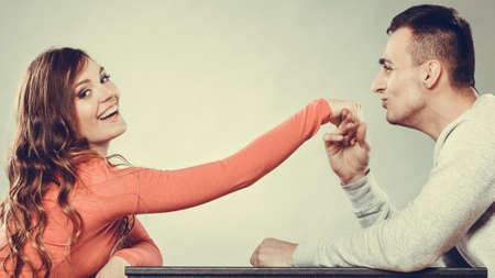 polite: Polite man, husband kissing smiling woman hand palm. Good, happy relationship.