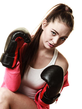�mancipation: Emancipation and feminist. Defense concept. Young fit woman boxing isolated on white.