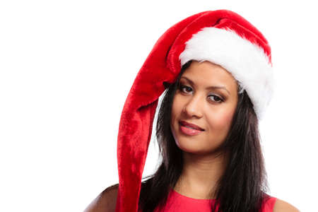 santa helper: Christmas winter happiness concept. Young woman girl mixed race wearing santa helper hat portrait. White background