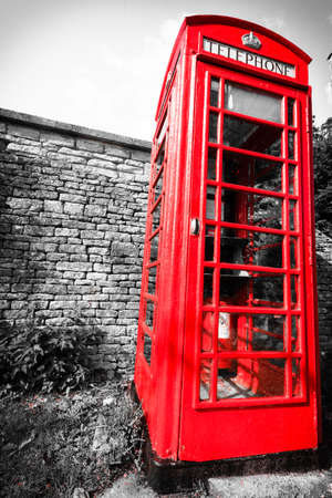 payphone: Traditional red telephone box booth or public payphone, village Bibury England UK Stock Photo