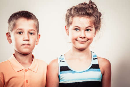 wacky: Crazy kids little girl and boy making silly face expression. Childhood fun. Stock Photo