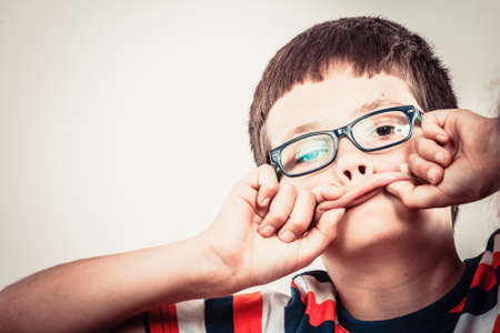 silly face: Crazy kid little boy making silly face expression. Childhood fun. Stock Photo