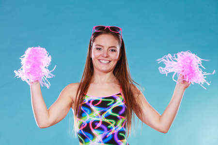 pom poms: Gorgeous young woman girl in swimsuit swimwear with pom poms on blue. Summer holiday vacation relax.