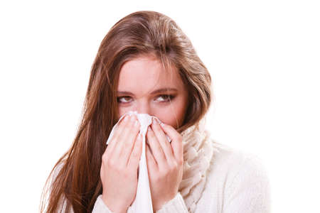 flue season: Flu cold or other virus. Sick woman girl with fever sneezing in tissue, suffering from quinsy. Health care.