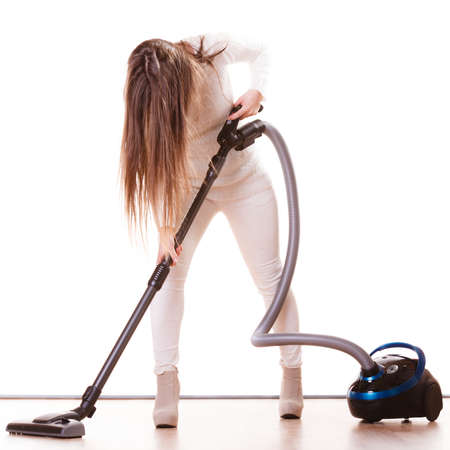 housework: Woman vacuuming the house. Funny girl with vacuum cleaner. Housework Stock Photo