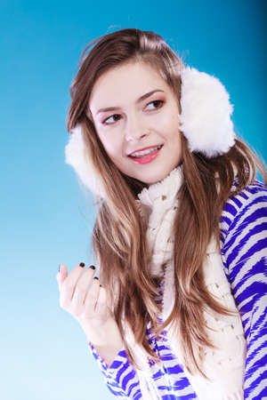 earmuff: Smiling teenage girl wearing fluffy white earmuff in winter fashion, cold time.