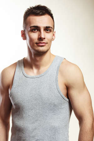 muscled: Handsome muscled sporty fit man. Portrait of young muscular guy in studio. Healthy lifestyle.