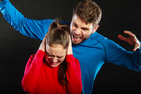 aggression: Husband abusing wife. Aggresive man screaming at crying scared woman. Domestic violence aggression. Bad relationship.
