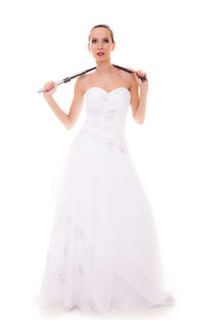 flogging: Wedding day. Full length young attractive bride in white dress with black leather flogging whip isolated on white background